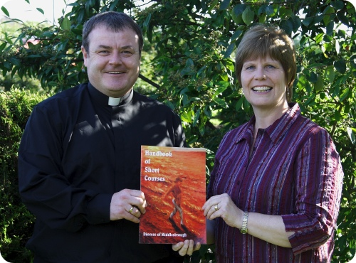 photo of Father John Lumley and Jane Cook at the handbook launch
