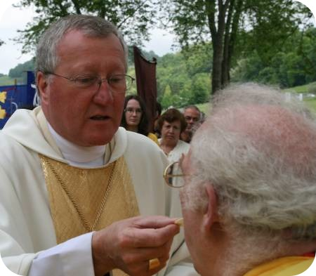 photo of Bishop giving Communion