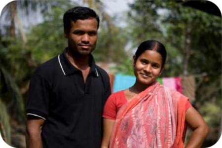 photo of Pobitra and Mollika whose house was destroyed by Cyclone Sidr and damaged again by Cyclone Aila