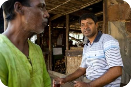 photo of Ananda (right), who works for Caritas Bangladesh in Kainmari