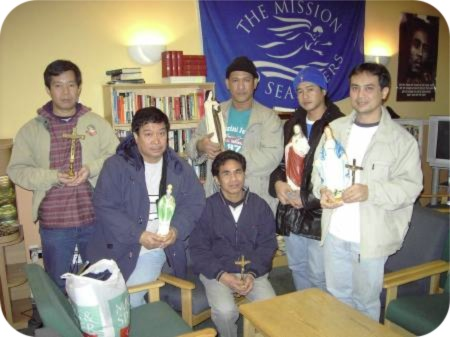photo of seafarers with statues and religious items donated by a local parishioner