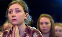 photo of young people praying