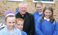 photo of Bishop Terry Drainey with some school children