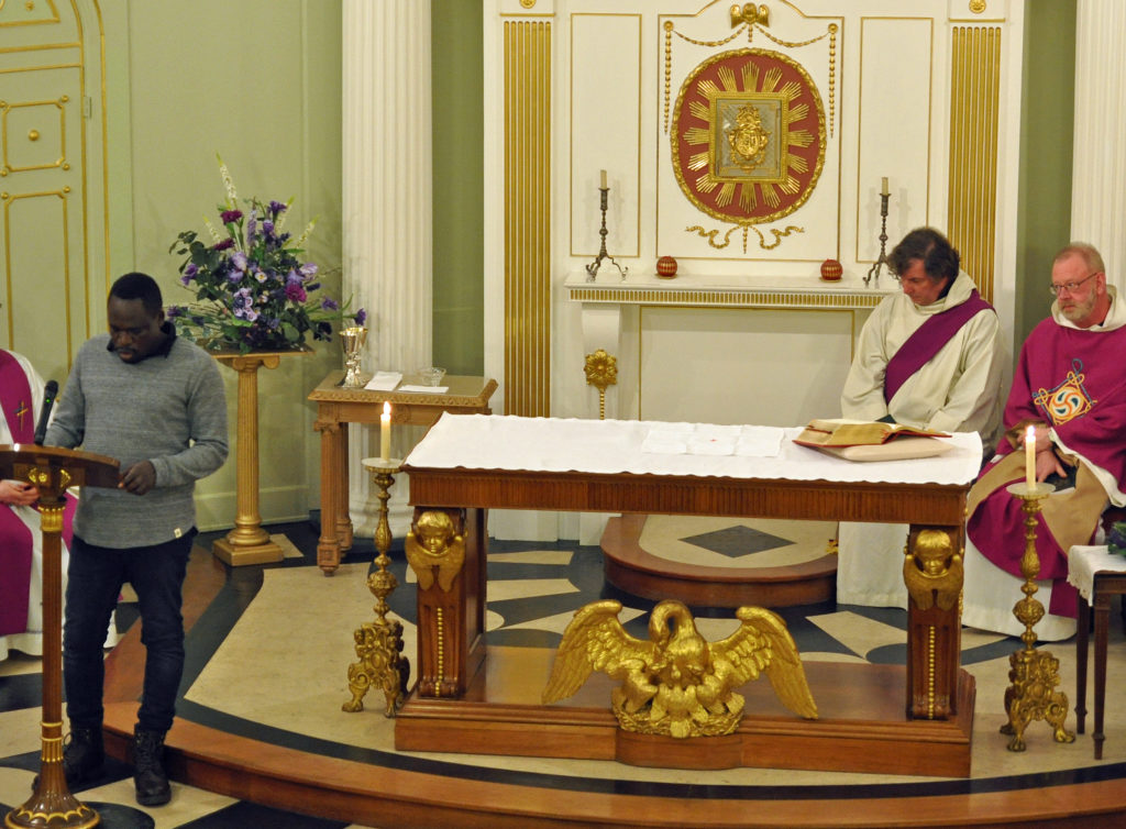 An LGBT rights defender from Kenya proclaiming God's Word at the launch Mass