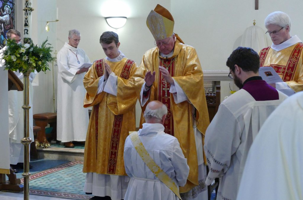 Bishop Terry laying on hands at the ordination of Father Francis Sutcliffe