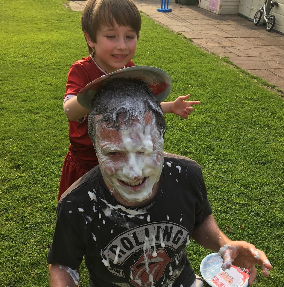 St Wilfrid's teacher Dan Jones gets hit with a custard pie