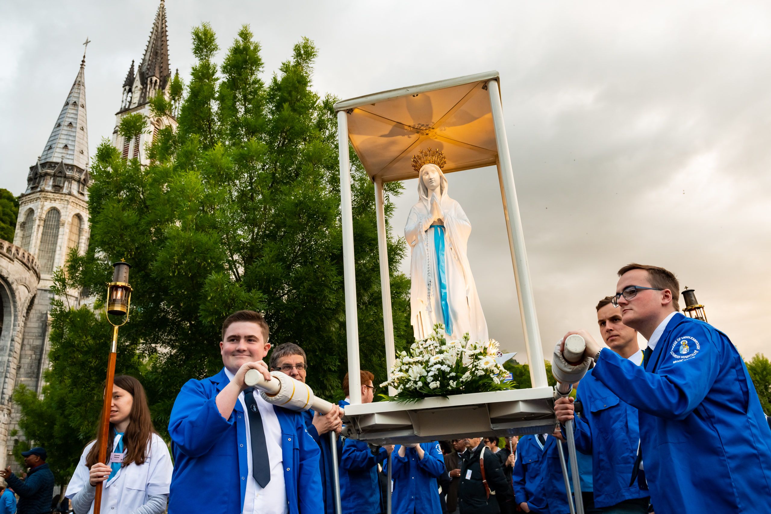 Matty Carpenter, Martin Thorpe, Kieran McIntyre and Ashley carrying the statue of Our Lady in the Torchlight Marian Procession – Photo courtesy of Lacaze, Lourdes