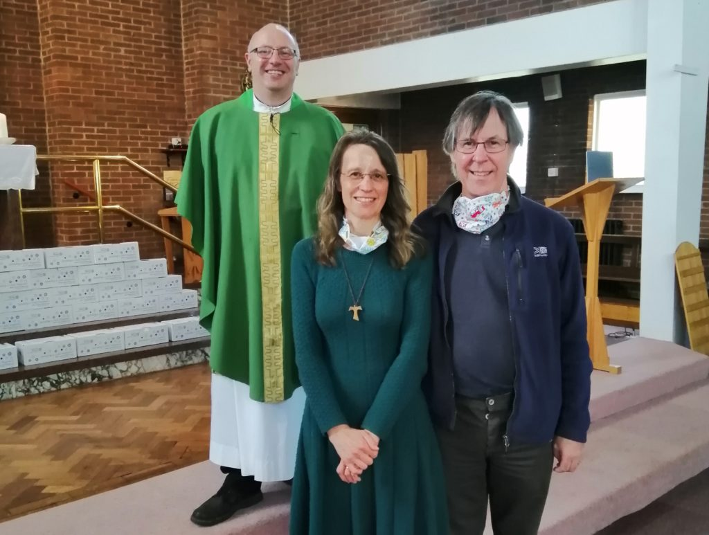 Father Bill Serplus Confirmed Joanna Bowe, with her husband David as her sponsor